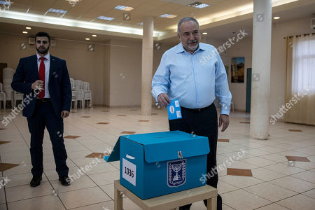 The leader of the Yisrael Beiteinu right-wing nationalist party Avigdor Liberman votes in the settlement of Nokdim, West Bank