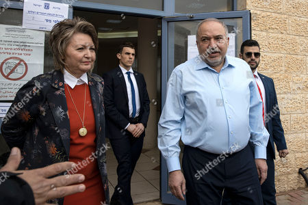 Stock Image of The leader of the Yisrael Beiteinu right-wing nationalist party Avigdor Liberman and is wife Ella leave the poling station after they voted in the settlement of Nokdim, West Bank