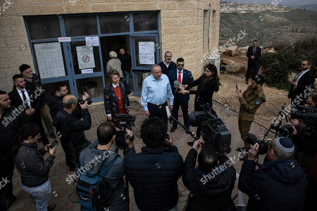 The leader of the Yisrael Beiteinu right-wing nationalist party Avigdor Liberman and is wife Ella leave the poling station after they voted in the settlement of Nokdim, West Bank