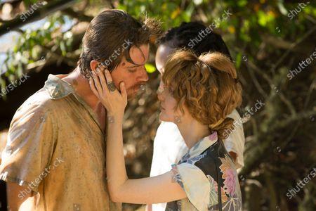 Garrett Hedlund as Mike Burden and Andrea Riseborough as Judy