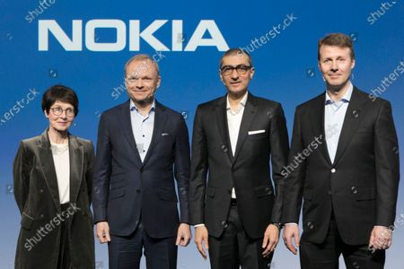 (L-R) Nokia's incoming chairwoman Sari Baldauf, appointed President and CEO Pekka Lundmark, outgoing business executive and CEO Rajeev Suri, and outgoing board chairman Risto Siilasmaa pose for a photo during a press conference in Espoo, Finland, 02 March 2020. Nokia's Board of Directors appointed Pekka Lundmark as the company's President and CEO. He is expected to take office on 01 September 2020.