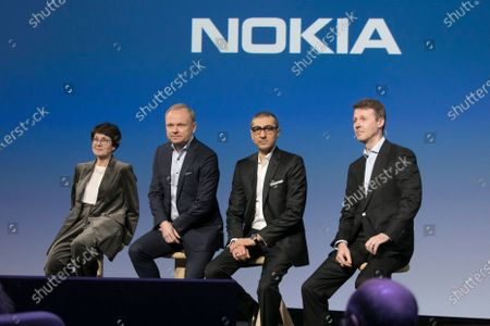 (L-R) Nokia's incoming chairwoman Sari Baldauf, appointed President and CEO Pekka Lundmark, outgoing business executive and CEO Rajeev Suri, and outgoing board chairman Risto Siilasmaa attend a press conference in Espoo, Finland, 02 March 2020. Nokia's Board of Directors appointed Pekka Lundmark as the company's President and CEO. He is expected to take office on 01 September 2020.