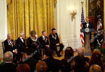 President Barack Obama on stage with (l-r) honorees Mel Brooks, Dave Brubeck, Grace Bumbry, Robert De Niro, and Bruce Springsteen