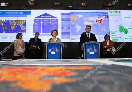 European Commission President Ursula von der Leyen, center left, and European Commissioner for Crisis Management Janez Lenarcic, center right, speak during a media conference regarding COVID-19 at the Emergency Response Coordination Center in Brussels, . From right, European Commissioner for Transport Adina Valean, European Commissioner for Home Affairs Ylva Johansson, European Commissioner for Health Stella Kyriakides, and European Commissioner for Economy Paolo Gentiloni