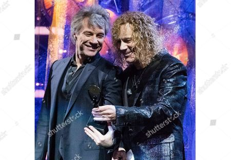 "Jon Bon Jovi, Tico Torres, Richie Sambora, David Bryan. Jon Bon Jovi, left, and David Bryan of the band Bon Jovi at the 2018 Rock and Roll Hall of Fame Induction Ceremony in Cleveland, Ohio. Bryan, the keyboardist for Bon Jovi is embarking on a busy 2020, with a new album and tour with one of America's favorite rock bands as well as opening his second Broadway musical, ""Diana"