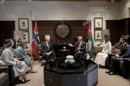 Jordan's King Abdullah II, center right, hosts Norway's King Harold, center left, with Jordan's Crown Prince Hussein, right, Jordan's Queen Rania, second right, and Norway's Queen Sonja, second left, at the Royal Palace, in Amman, Jordan