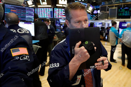 Trader Robert Charmak works on the floor of the New York Stock Exchange, . Stocks are opening higher on Wall Street following a seven-day rout brought on by worries that the spreading coronavirus outbreak will stunt the global economy