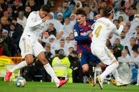 Barcelona's French forward Antoine Griezmann and Real Madrid's French defender Raphael Varane and Real Madrid's Spanish defender Sergio Ramos