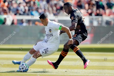 "Javier Hernandez, Maynor Figueroa. Los Angeles Galaxy forward Javier ""Chicharito"" Hernandez (14) moves the ball around Houston Dynamo defender Maynor Figueroa, right, during the first half of an MLS soccer match, in Houston"
