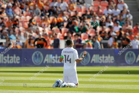 "Javier Hernandez. Los Angeles Galaxy forward Javier ""Chicharito"" Hernandez (14) prays at center field before the opening kick off of an MLS soccer match against the Houston Dynamo, in Houston"