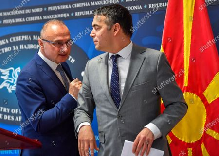 Croatian Foreign Minister Gordan Grlic Radman (L) talks with his Macedonian counterpart Nikola Dimitrov (R) after their joint press conference in Skopje, Republic of North Macedonia on 02 March 2020. Gordan Grlic Radman, Minister of Foreign and European Affairs of the Republic of Croatia, arrived for an one-day work visit to North Macedonia. Croatian FM said that Croatia who currently has the presidency of the Council of the EU, passed on its support for the start of North Macedonia's and Albania's negotiation process for joining the European Union.