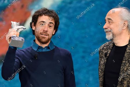 Stock Photo of Elio Germano, winner of the Silver Bear as Best actor to the 70th International Film Festival with the film on the painter Ligabue 'Volevo nascondermi', the director of the film Giorgio Diritti