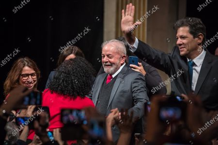 (L-R) Former Brazilian President Luis Inacio Lula da Silva and former presidential candidate of the Workers' Party, Fernando Haddad wave to the public during the ceremony where Lula da Silva received his diploma as Honorary Citizen at the City Hall of Paris, France, 02 March 2020. On 03 October 2019, Luiz Inacio Lula da Silva received the title of Honorary Citizen of Paris City Hall.