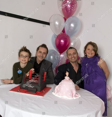 Tony and Barrie Drewitt-Barlow with their ten-year-old twins Aspen and Saffron
