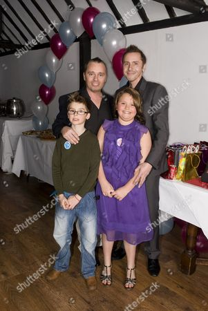 Barrie and Tony Drewitt-Barlow with their ten-year-old twins Aspen and Saffron