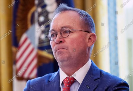 Acting Chief of Staff Mick Mulvaney watches as President Trump speaks to the media about the coronavirus as he meets with Colombian President, during a meeting in the Oval Office