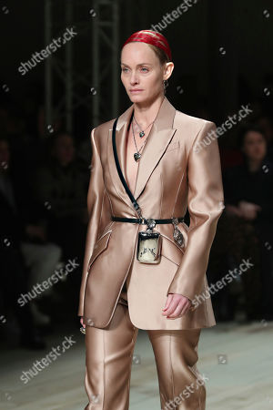 Stock Photo of Model Amber Valletta wears a creation for the Alexander McQueen fashion collection during Women's fashion week Fall/Winter 2020/21 presented in Paris
