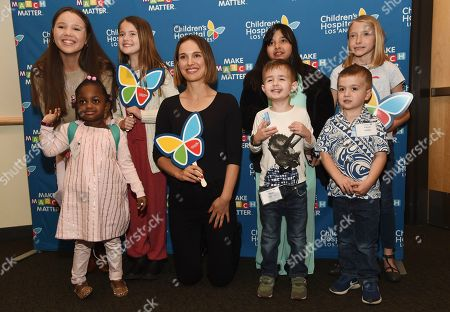 Natalie Portman, Grace Rose, Ella Annear, Kairi Ramirez, Saylor Pierson, Kennedy Lewis, Elliot Fletcher, Pierce Kelly. Actress Natalie Portman, center, poses with former and current Children's Hospital Los Angeles patients at the launch of the Fifth Annual Make March Matter fundraising campaign for the hospital, in Los Angeles. From left, back row: Grace Rose, Ella Annear, Kairi Ramirez and Saylor Pierson. From left, front row: Kennedy Lewis, Elliot Fletcher and Pierce Kelly