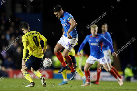 Arsenal's Dani Ceballos left, challenges for the ball with Portsmouth's Gareth Evans during the English FA Cup fifth round soccer match between Portsmouth and Arsenal at Fratton Park stadium in Portsmouth, England