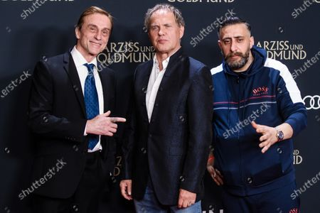 Stock Photo of German actors  Andre Hennicke, Uwe Ochsenknecht and Kida Khodr Ramadan attend the premiere of 'Narziss und Goldmund' (Narcissus and Goldmund) in Berlin, Germany, 02 March 2020. The movie based on the book of German-Swiss writer Hermann Hesse will be released in German theatres on 12 March 2020.