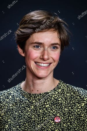 Stock Photo of Miriam Stein shows an extinction rebellion button on her dress as she attends the premiere of 'Narziss und Goldmund' (Narcissus and Goldmund) in Berlin, Germany, 02 March 2020. The movie based on the book of German-Swiss writer Hermann Hesse will be released in German theatres on 12 March 2020.