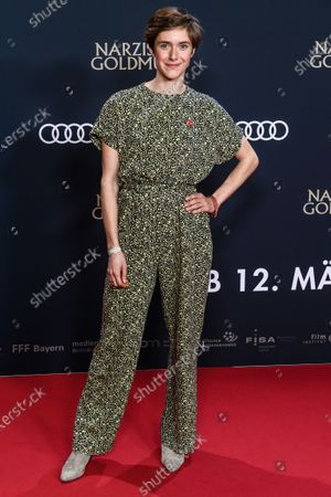 Stock Image of Miriam Stein shows an extinction rebellion button on her dress as she attends the premiere of 'Narziss und Goldmund' (Narcissus and Goldmund) in Berlin, Germany, 02 March 2020. The movie based on the book of German-Swiss writer Hermann Hesse will be released in German theatres on 12 March 2020.