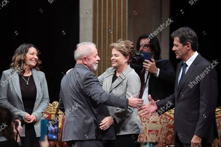 Brazilian former President Luiz Inacio Lula da Silva, center left, attends with his girlfriend Rosangela da Silva, left, former Brazilian president Dilma Rousseff, center right, and former Sao Paolo Mayor Fernando Haddad, right, a ceremony to receive the honorary citizenship of Paris