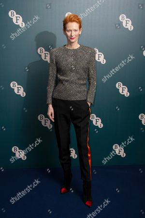 Tilda Swinton poses for photographers upon arrival at her BFI Fellowship reception at a central London hotel