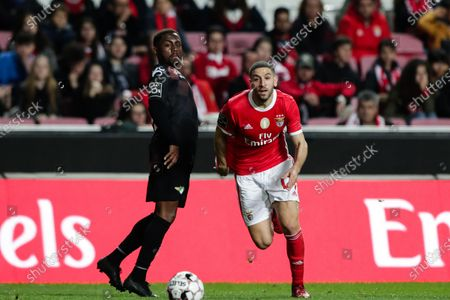SL Benfica's player Adel Taarabt (R) fights for the ball with Moreirense's Bilel during their first league soccer match held at the Luz stadium in Lisbon, Portugal, 02 March 2020.