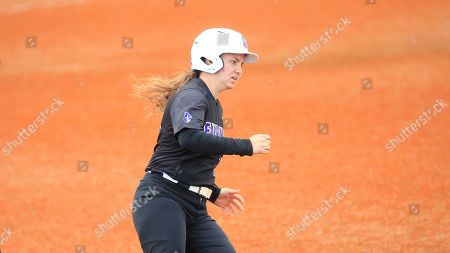 Furman's Natalie Morgan (18) rounds first base during an NCAA college softball game against Harvard, in Boiling Springs, N.C