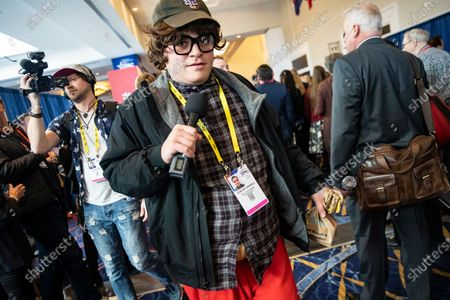 Film director Vincent Shkreli, with Daily Caller, walks around the Conservative Political Action Conference, CPAC 2020, dressed as liberal documentary filmmaker Michael Moore in Oxon Hill, Md.