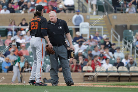 San Francisco Giants' Jeff Samardzija talks with home plate umpire Bill Miller after the third inning of a spring training baseball game against the Arizona Diamondbacks, in Scottsdale, Ariz