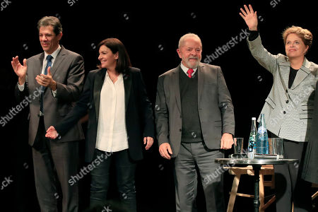 From left to right, former Brazilian mayor of Sao Paulo Fernando Haddad, Paris mayor Anne Hidalgo, left, former Brazilian Presidents Luiz Inacio Lula da Silva and Dilma Roussef acknowledge applauses during a meeting for the upcoming mayoral elections in Paris . France local elections starting March 15, 2020