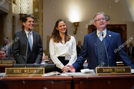 Stock Photo of Kentucky State Senator Damon Thayer introduces actress Jennifer Garner and Mark Kennedy Shriver, President of Save The Children Action Network, on the floor of the Senate Chambers at the Capitol building in Frankfort, Ky