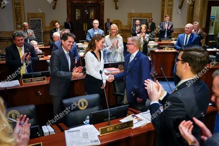Stock Image of Kentucky State Senators welcome actress Jennifer Garner and Mark Kennedy Shriver, President of Save The Children Action Network, to the floor of the Senate Chambers at the Capitol building in Frankfort, Ky