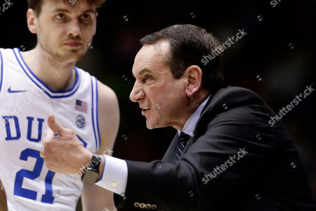 Duke head coach Mike Krzyzewski speaks with Duke forward Matthew Hurt (21) and other players during a break in the action in the second half of an NCAA college basketball game against North Carolina State in Durham, N.C