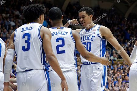Stock Picture of Duke forward Justin Robinson, right, guard Cassius Stanley (2) and guard Tre Jones (3) react during the second half of an NCAA college basketball game against North Carolina State in Durham, N.C