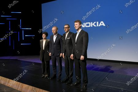 Nokia Vice Chairman Sari Baldauf, new President and CEO Pekka Lundmark, resigning President and CEO Rajeev Suri and Chairman of the Board Risto Siilasmaa pose for pictures