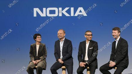Stock Image of Nokia Vice Chairman Sari Baldauf, new President and CEO Pekka Lundmark, resigning President and CEO Rajeev Suri and Chairman of the Board Risto Siilasmaa