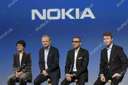 Stock Photo of Nokia Vice Chairman Sari Baldauf, new President and CEO Pekka Lundmark, resigning President and CEO Rajeev Suri and Chairman of the Board Risto Siilasmaa
