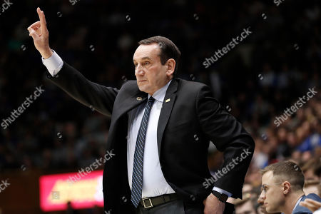 Duke head coach Mike Krzyzewski directs his players against North Carolina State during the first half of an NCAA college basketball game in Durham, N.C