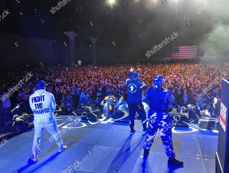 Stock Photo of Chuck D, Public Enemy Radio. Hip-hop legend Chuck D, middle, with Public Enemy Radio perform at a rally for Democratic presidential candidate Sen. Bernie Sanders, I-Vt., at Los Angeles Convention Center in Los Angeles. Public Enemy has abruptly fired founding member Flavor Flav following a public spat over a decision by members of the rap pioneers to perform at a Bernie Sanders campaign event
