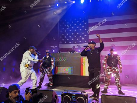 Chuck D, Public Enemy Radio. Hip-hop legend Chuck D, second from right, with Public Enemy Radio performs at a rally for Democratic presidential candidate Sen. Bernie Sanders, I-Vt., at Los Angeles Convention Center in Los Angeles. Public Enemy has abruptly fired founding member Flavor Flav following a public spat over a decision by members of the rap pioneers to perform at the Bernie Sanders campaign event
