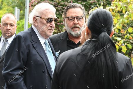 New Zealand actor Russell Crowe (C) and former radio host John Laws (L) during the funeral service for Caroline Laws at St Mark's Church in Sydney, Australia, 03 March 2020.