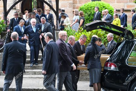 The casket of Caroline Laws is loaded into a hearse as her husband and former radio host John Laws (L) leaves the funeral service for Caroline Laws at St Mark's Church in Sydney, Australia, 03 March 2020.