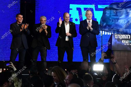 Leaders of the Israeli Blue and White Party, former chief of staff of the Israeli army Benny Gantz (R), former finance minister Yair Lapid (2-L), former chief of staff of the Israeli army, Gabi Ashkenazi (L) and former Defence minister Moshe Ya'alon (C) thank supporters during the final elections event in Tel Aviv, Israel,  02 March 2020.