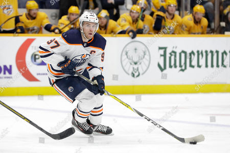 Edmonton Oilers center Connor McDavid plays against the Nashville Predators in the third period of an NHL hockey game, in Nashville, Tenn