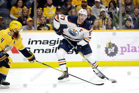 Edmonton Oilers center Connor McDavid (97) plays against the Nashville Predators in the first period of an NHL hockey game, in Nashville, Tenn