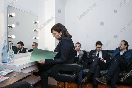 Anne Hidalgo inside her private room, with Ian Brossat, Patrick Klugman and Jean-Marc Germain in the backgroud during the meeting 'La Planete en Commun'.