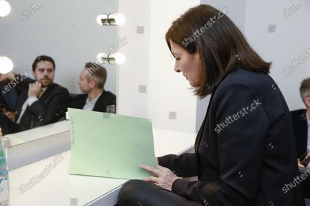Stock Photo of Anne Hidalgo with Patrick Klugman and Ian Brossat (in the background) in her private room during the meeting 'La Planete en Commun'.
